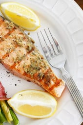 Salmon fillets seasoned with a garlic, Dijon herb sauce and served with a squeeze of fresh lemon... delicious!!