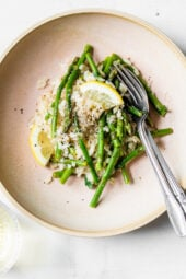 Creamy asparagus risotto, cooked with fresh herbs, Parmigiano-Reggiano and a touch of lemon. Perfect Spring meatless main dish or wonderful topped with grilled shrimp or scallops.