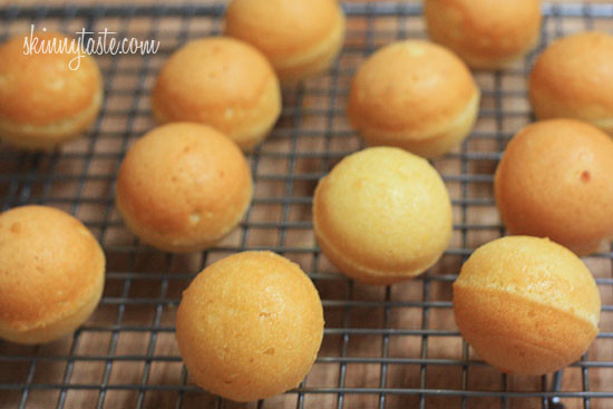 Cooling the baked cake balls on a rack.