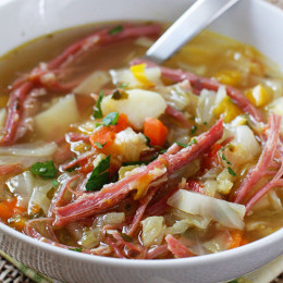 Corned Beef and Cabbage Soup made with cabbage, potatoes, bell peppers and aromatics simmered on the stove with corned beef create this wonderful one pot meal – a fun twist on a Classic Irish dish!