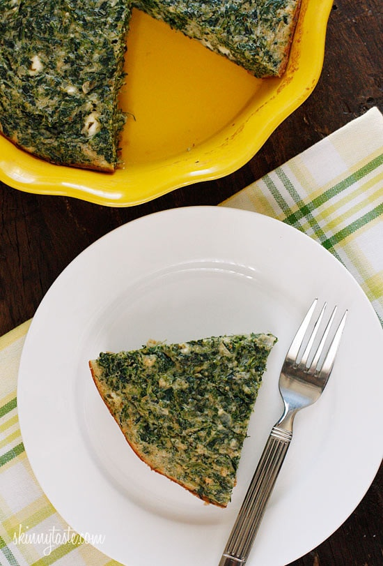 A simple Greek inspired Easy Crust-less Spinach and Feta Pie combining savory flavors such as spinach, feta, Asiago cheese, dill and scallions. Perfect to take to a potluck!