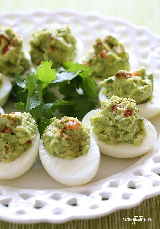 Guacamole Deviled Eggs make a healthy appetizer made with hard boiled eggs filled with mashed avocado, cilantro and lime juice.