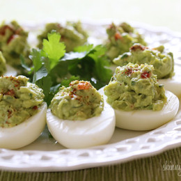 My mom adds hard boiled eggs to her guacamole, so I thought why not add guacamole to hard boiled eggs? The results were lovely, and since I was testing them out for the blog, I actually enjoyed them for lunch.