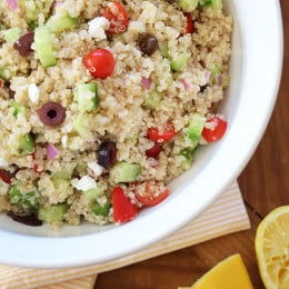 A protein packed salad with Mediterranean flavors – quinoa, cucumbers, tomatoes, kalamata olives, red onion, extra virgin olive oil, fresh lemon and a little feta cheese combined makes a healthy salad with fresh clean ingredients.