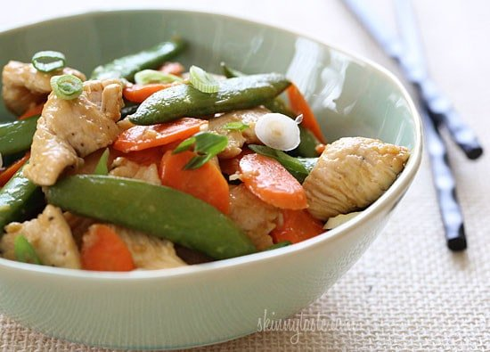 Spring vegetables and chicken breast strips sauteed with fresh ginger, lime juice, and a touch of soy sauce for a quick weeknight meal. I love making stir fries for dinner, what's better than throwing veggies and protein into a wok and having dinner ready in minutes.