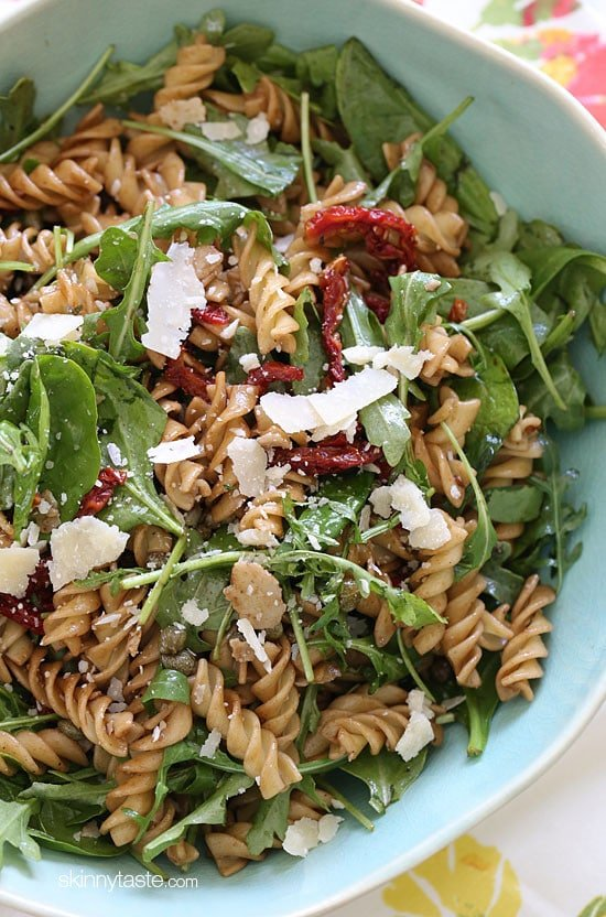 I love making this mayo-less summer pasta salad with arugula, spinach, sun dried tomatoes, capers, fresh shaved Parmesan cheese and a splash of balsamic and oil.