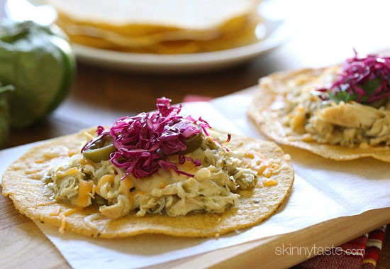 Chicken tenders are slow cooked in the crock pot with salsa verde, then served on a crispy corn tostada and topped with melted cheese, jalapeño and a simple cabbage slaw made with red cabbage, lime juice, cilantro and salt. I could eat these everyday!!
