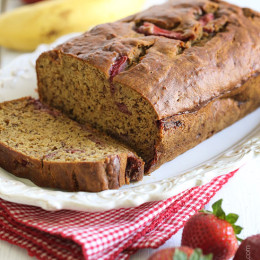 This banana bread is moist and delicious, made with white whole wheat flour, sweet roasted strawberries and ripe bananas, with just a smidgen of butter, so you can enjoy a slice without the guilt!
