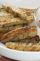 Strips of eggplant, breaded and baked until golden and served with a quick marinara sauce. Serve these as a snack, appetizer or side dish. I'm making these tonight with an eggplant I bought at the farmer's market and figured I would revive the recipe from the archives. Enjoy!