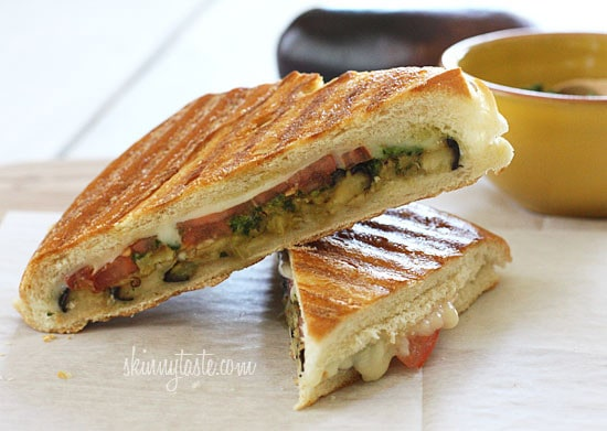 A perfect summer lunch panini made with eggplant, tomatoes, mozzarella and skinny pesto on crispy French bread. Make this for one, or for the whole family.