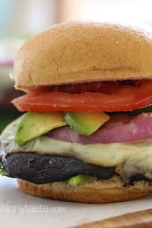I set out to make a great tasting grilled portobello mushroom burger that even a meat lover would love. The mushrooms are marinated then grilled and topped with melted Swiss Cheese, grilled red onion,  tomatoes, spinach, and avocado – yum!!