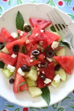 Chilled Watermelon Cucumber Feta Salad tossed with Kalamata olives, fresh mint and a drizzle of balsamic glaze – refreshing, light and delicious!
