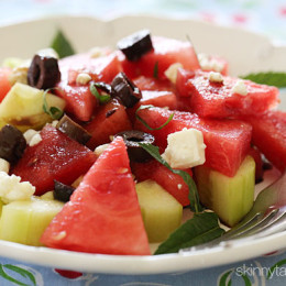 Salad with chilled watermelon and chunks of cucumber are tossed with feta cheese, Kalamata olives, fresh mint and a drizzle of balsamic glaze.