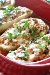 "A fun, easy twist on eggplant parmesan – these baked eggplant ""boats"" are hollowed out and stuffed with chicken sausage, tomato sauce and mozzarella."