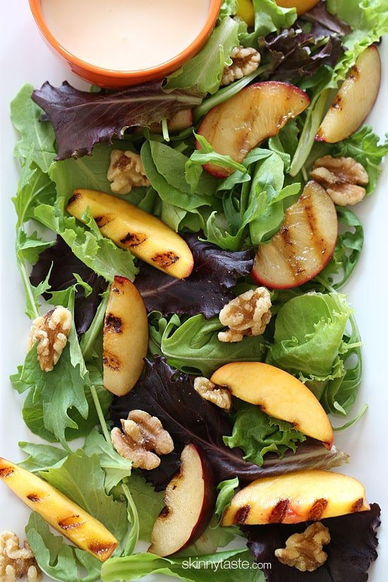 Grilled stone fruit like peaches and plums served over baby greens with walnuts and a sweet honey goat cheese dressing, this salad is light and delicious!