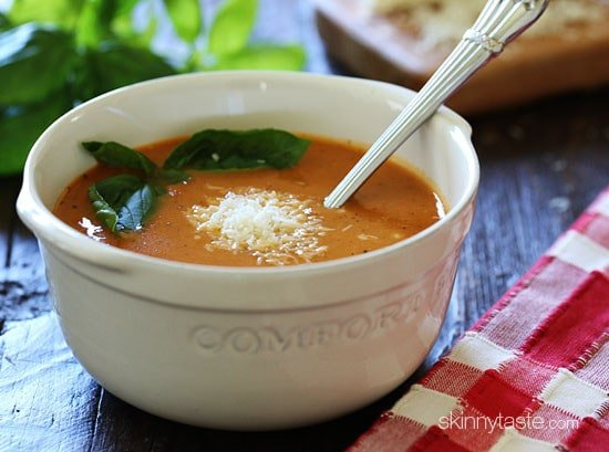 This creamy, rich crock pot tomato soup is made in the slow cooker with tomatoes, herbs, milk and Pecorino Romano cheese, plus the cheese rind for added flavor.