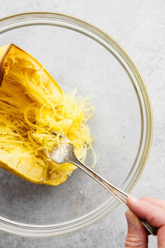 This easy, cheesy baked spaghetti squash is a healthier take on mac and cheese! It's cheesy, loaded with vegetables and feels like comfort food, without the calories and carbs.