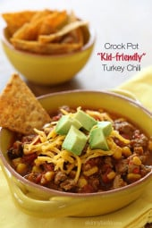 This CrockPot turkey chili recipe is just for the kiddos (or picky family members)! A kid-friendly chili with ground turkey, corn, bell pepper, tomatoes and spices. Serve it with some chips on the side for the perfect back to school lunch.