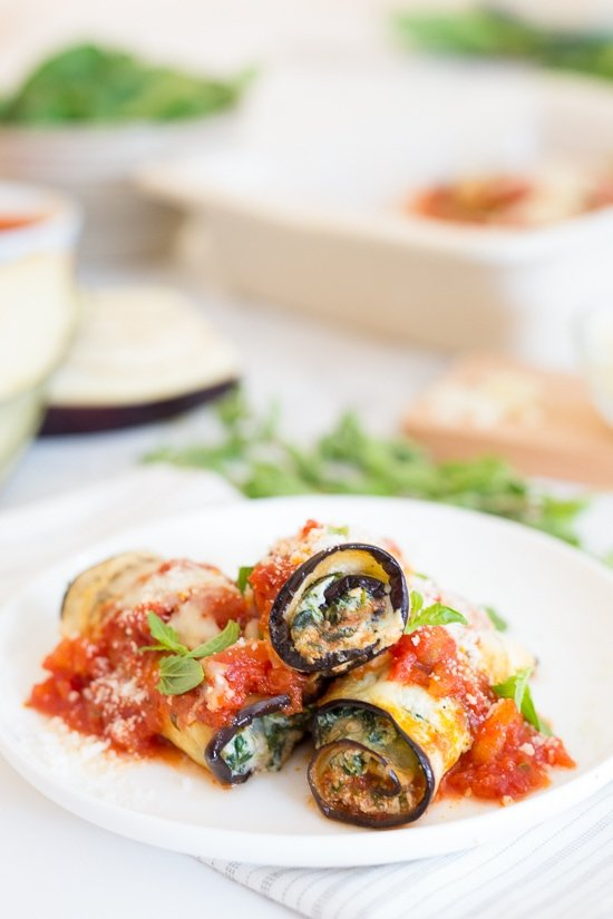The best low-carb Eggplant Rollatini, made with thin slices of eggplant filled with a spinach and cheese ricotta filling, topped with marinara and mozzarella cheese. No frying, no breadcrumbs!