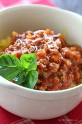 Roasted Spaghetti squash topped with a simple-yet-delicious meat sauce simmered with tomatoes, onions, carrots and celery. I love this low-carb dish, you won't miss the pasta!