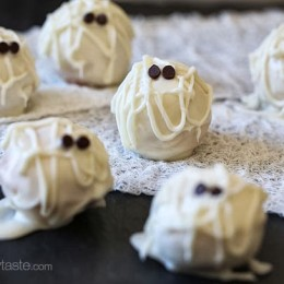 Easy Skinny Halloween mummy cake balls made light by using a box cake mix, egg whites and fat free Greek yogurt – no butter required!