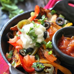 Baked sweet potato wedges topped with my favorite nacho toppings – these are dangerously good!!