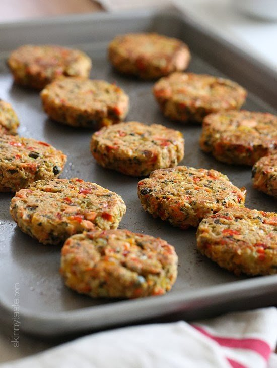 These baked salmon cakes are light, healthy and a perfect Holiday appetizer! With wild Alaskan salmon, peppers, capers, breadcrumbs and a zesty avocado dressing