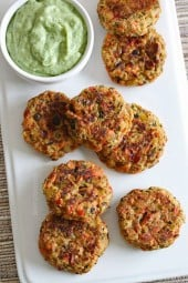 Baked salmon cakes make the perfect Holiday appetizer, made with wild Alaskan salmon, diced peppers, capers and breadcrumbs