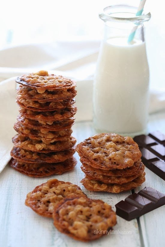 These delicious dark chocolate oatmeal lace cookies are light, crisp and chewy, made with basic ingredients like oats, flour, butter, sugar and spices– then once baked they are sandwiched together with melted dark chocolate.