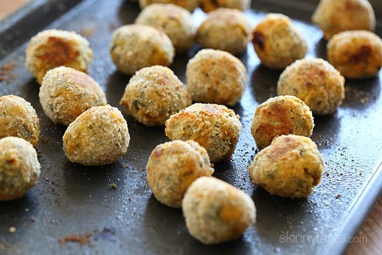 A sheet pan with baked crispy mini arancini rice balls