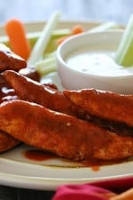 Quick and easy – these buffalo chicken strips are spicy and delicious! I like to serve them with my homemade skinny blue cheese dressing and celery sticks on the side for a hot and spicy appetizer.