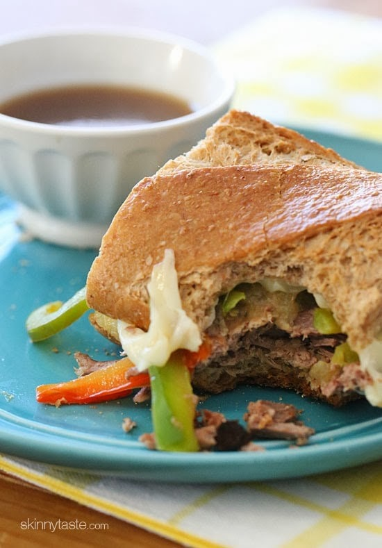 If this slow cooker french dip sandwich filled with beef, melted cheese, caramelized onions and a beef broth to dip in sounds appealing, you NEED to make these!
