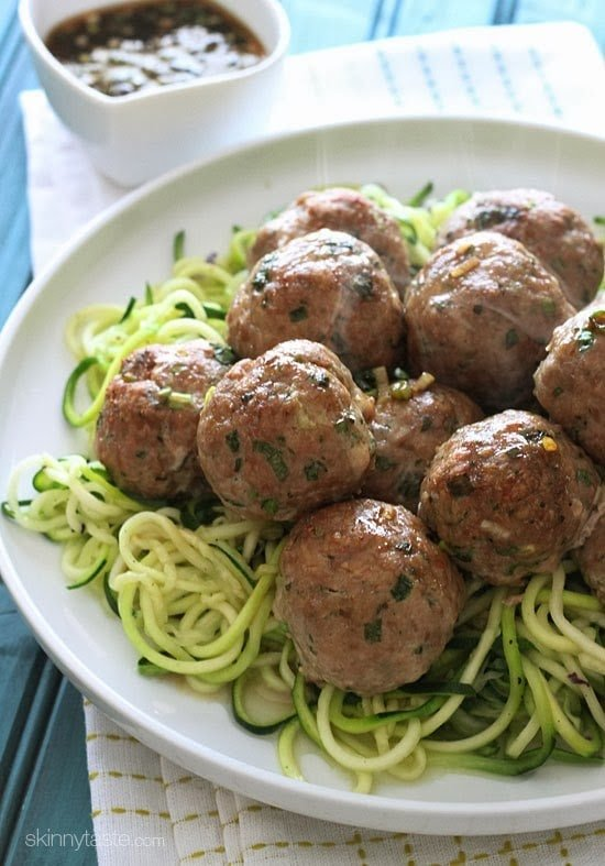 These Asian inspired meatballs are out of this world! Made with ground turkey, ginger, scallions, cilantro and sesame oil with a tangy sesame-lime dipping sauce
