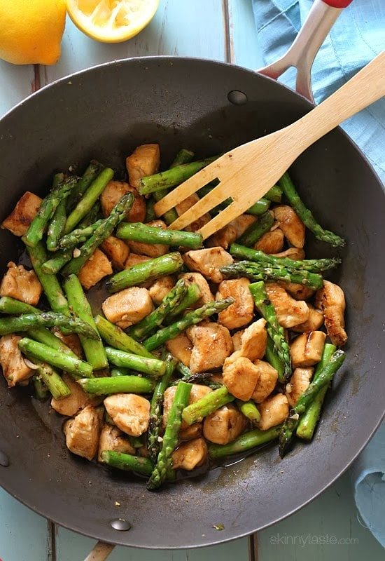 This quick chicken and asparagus stir fry made with chicken breast, fresh lemon, garlic and ginger is the perfect fast weeknight dish.