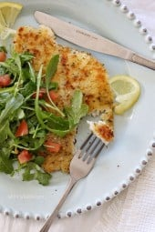 Breaded flounder lightly pan sauteed and topped with an arugula, lemon and tomato salad – a simple yet delicious way to prepare fish. Perfect for Lent, or any night you're in the mood for fish.
