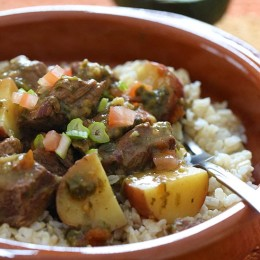 Crock pot Carne Guisada is a slow cooked Latin beef stew with baby red potatoes and Latin seasonings. Serve this topped with fresh aji picante – it's is a must and really brightens the flavors and rounds out the dish!