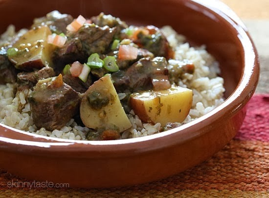 Crock pot carne guisada is a slow cooked Latin beef stew with baby red potatoes and Latin seasonings. Serve this topped with fresh aji picante – it's a must and really brightens the flavors and rounds out the dish!