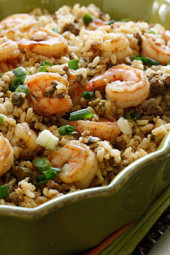 "A healthier twist on a Cajun classic, the addition of shrimp turns this ""dirty brown rice"" into a fabulous main dish. I'd like to think of this as a Cajun shrimp fried rice. With Mardi Gras ending tomorrow, I thought this would be the perfect timing to share this recipe from the archives because I LOVE this dish!"