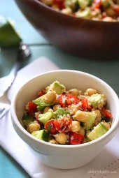 Quinoa chickpea and avocado salad with cucumbers, tomatoes, red onion, lime juice and cilantro – a flavorful vegetarian salad loaded with protein, fiber and healthy fats.