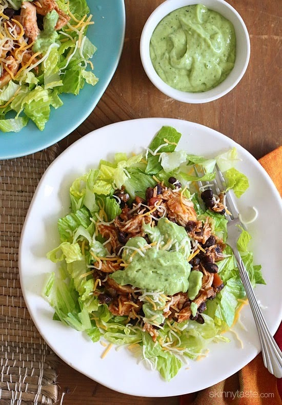 This simple slow cooker chicken taco salad is high in fiber and protein which means it's very satisfying – all for under 300 calories. Trust me, you won't miss the tortillas!
