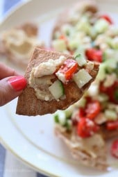 These Greek Nachos are a lighter, healthier Greek twist on traditional nachos – made with whole wheat pita chips, hummus, cucumbers, tomatoes and feta.