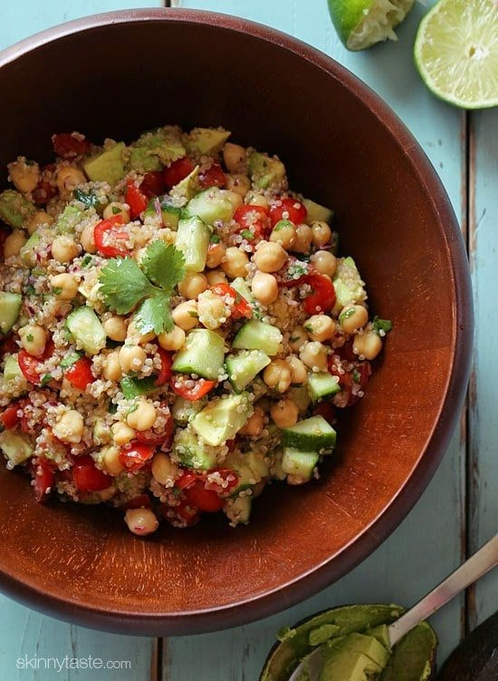 Quinoa chickpea and avocado salad with cucumbers, tomatoes, red onion, lime juice and cilantro – this flavorful vegetarian salad is loaded with protein, fiber and healthy fats. Chickpeas (garbanzo beans)are my new favorite legume. This is also vegan, gluten-free and dairy-free and under 250 calories.