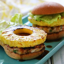 If I can't be in paradise, at least I can bring a little paradise to my backyard with these grilled shrimp burgers topped with grilled pineapple and a homemade pineapple teriyaki sauce – just under 300 calories!