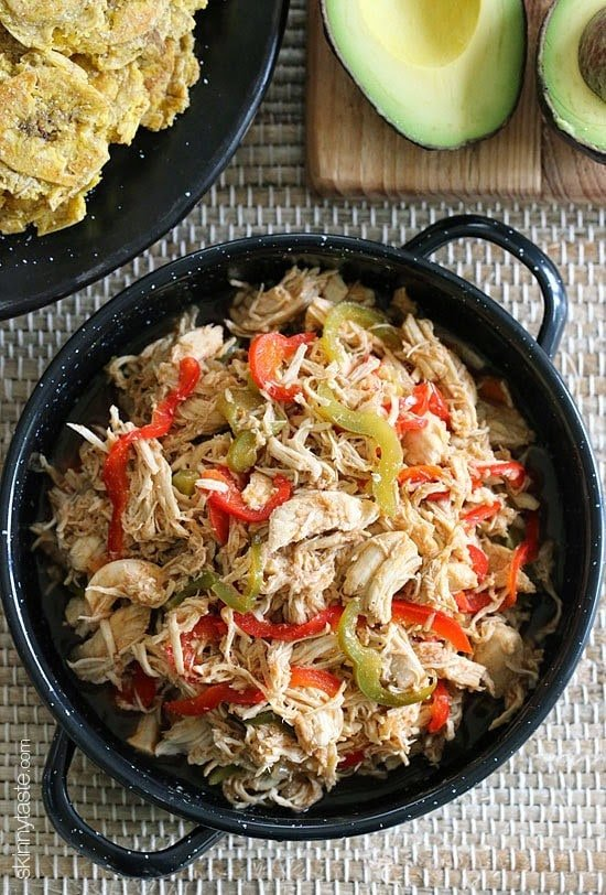 This Cuban inspired dish is made with shredded chicken breast cooked in the slow cooker, then sauteed with bell peppers, onions, cumin and lots of Latin flavor! If you have leftover rotisserie chicken, you can use that instead and skip the slow cooker!