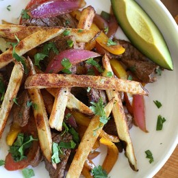 "I took one of Peru's most emblematic dishes, ""Lomo Saltado"" and lightened it up a bit – without losing any of it's amazing flavor. This dish is made with strips of sirloin seasoned with cumin, stir fried with tomatoes, red onion, soy sauce, cilantro and finished with french fries – what a combination right? Well trust me, it works!"