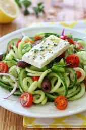 Spiralized Greek Cucumber Salad with Lemon and Feta is delicious, the perfect light dish. In Greece, Greek salads do not have lettuce, instead they are made with fresh cucumber, tomatoes, bell pepper, olives, red onion, oregano, lemon juice, olive oil, and fresh feta – delicious!