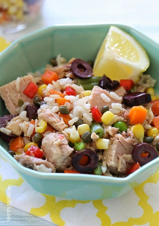 Italian tuna and brown rice salad using two basic pantry items—tuna and brown rice – plus capers, good quality chopped olives, frozen mixed vegetables and fresh lemon juice, you can create this easy, make-ahead, healthy salad loaded with flavor and perfect to pack for lunch or a picnic!