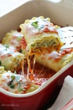 These EASY lasagna rolls are stuffed with zucchini, ricotta and Parmesan, then topped with marinara and mozzarella cheese – delicious, kid friendly and perfect if you want to feed a crowd.