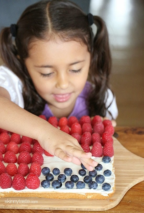 "Red, White and Blue fruit ""pizza"" is more like a cookie bar, topped with cream cheese frosting and fruit."