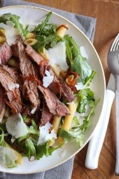 Grilled steak, arugula and pasta salad is topped with sweet balsamic caramelized onions and fresh shaved Parmesan. I'm a sucker for a good steak salad, and this one is AWESOME!